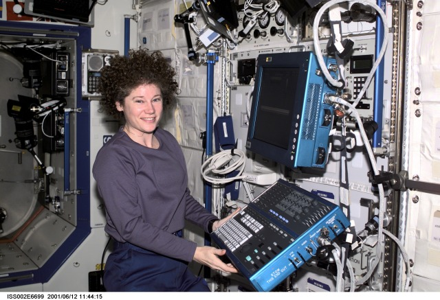 Astronaut Susan J. Helms, Expedition Two flight engineer, works at the Human Research Facility's (HRF) Ultrasound Flat Screen Display and Keyboard Module in the Destiny/U.S. Laboratory.