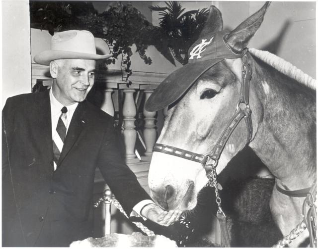 Charlie Finley and the A's mascot, Charlie O., the Missouri mule.