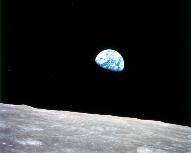 """Earthrise,"" one of the most powerful and iconic images from the Apollo program, was taken in December 1968 during the Apollo 8 mission. This view of the rising Earth greeted the Apollo 8 astronauts as they came from behind the Moon after the first lunar orbit. Used as a symbol of the planet's fragility, it juxtaposes the grey, lifeless Moon in the foreground with the blue and white Earth teeming with life hanging in the blackness of space."