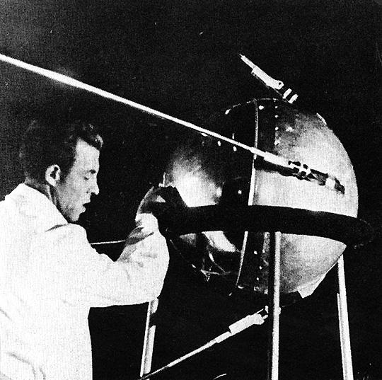 A Soviet engineer and Sputnik 1.