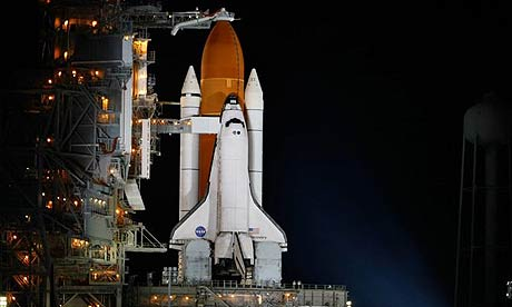 The Space Shuttle on the launch pad.
