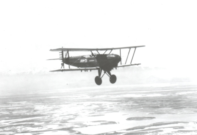 An airmail pilot on route 5 between Seattle and Salt Lake City flies over the wasteland of the Great Salt Lake in 1927.
