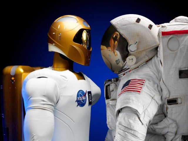 Robonaut and astronaut faceoff.