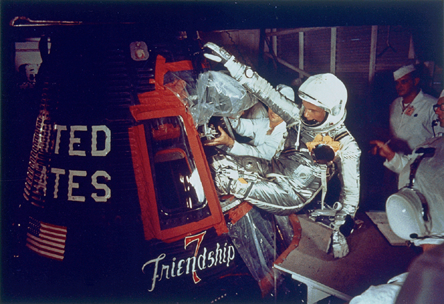 "John Glenn Climbing into his ""Friendship 7"" Mercury capsule."