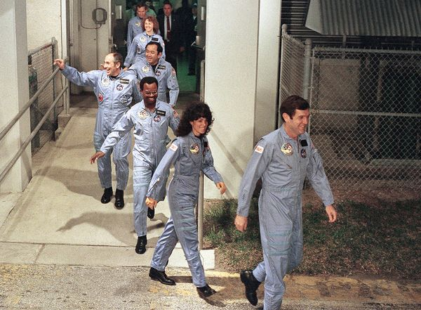 The Challenger crew during the walk-out to the van taking them to Challenger at Launch Complex 39.
