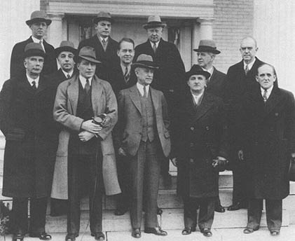 On 17 December 1936, the NACA Executive Committee met at the home of Orville Wright, after which it posed out front with the host in the front row, center NACA's technical assistant in Europe, John J. Ide, an infrequent attender of NACA meetings, is in the center of the back row between John Victory and George Lewis.