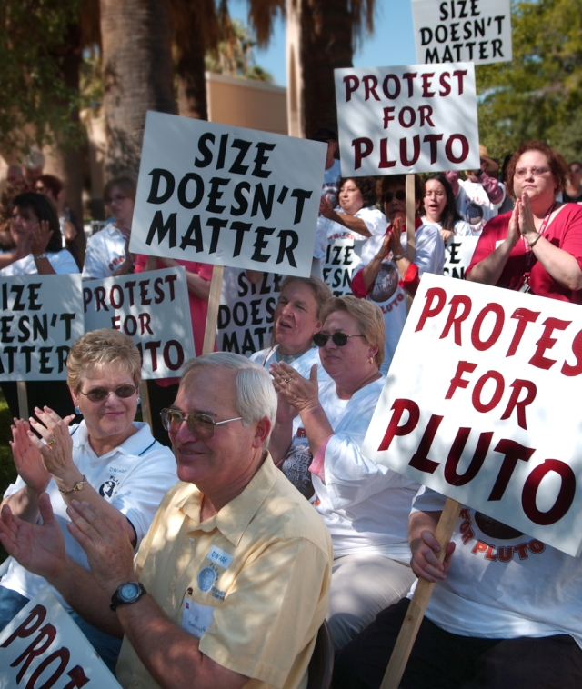 People gather to protest Pluto's loss of status as a planet, September 1, 2006..