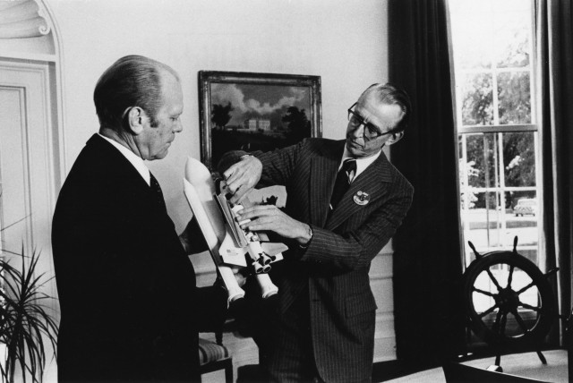 NASA Administrator James C. Fletcher shows the projected Space Shuttle to President Gerald R. Ford in 1976.
