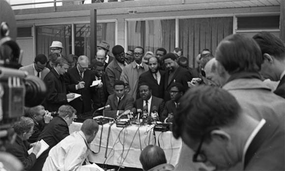The Rev. Ralph Abernathy (center), flanked by Andrew Young, Bernard Scott Lee and the Rev. Jesse Jackson, speaks at a press conference following the April 1968 assassination of Martin Luther King Jr.