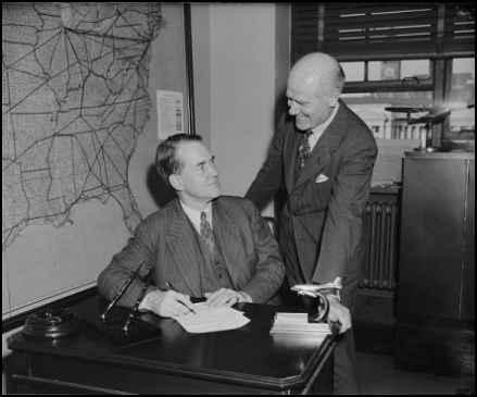 Edward P. Warner (seated) in 1939 during his time at the CAA.