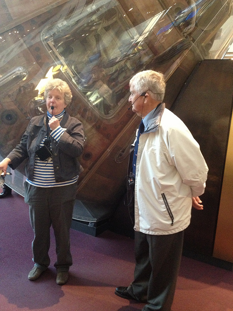 Fred and Elizabeth Nesbitt  speaking with visitors at the National Air and Space Museum.