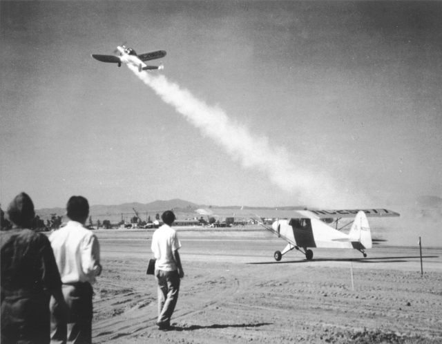 "This image from 1941 shows the Ercoupe, a ""rocket-assisted"" airplane, taking off using a shorter runway than the plane still on the ground. Both planes started at the same position and time."