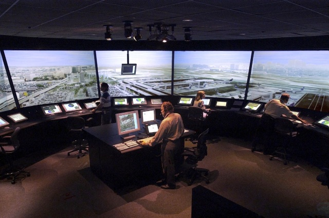 Tower controllers test out NASA new surface automation tools in a simulation at NASA's Future Flight Central air traffic control tower simulator.
