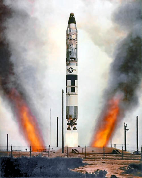 A U.S. Air Force LGM-25C Titan II ICBM undergoes a test launch from an underground silo. Unlike Titan I missiles, which had to be raised to the surface before launch, the Titan II's liquid rocket engines were ignited while it was still in the silo. Therefore the silo had to be constructed with flame and exhaust ducts as shown in this photograph.