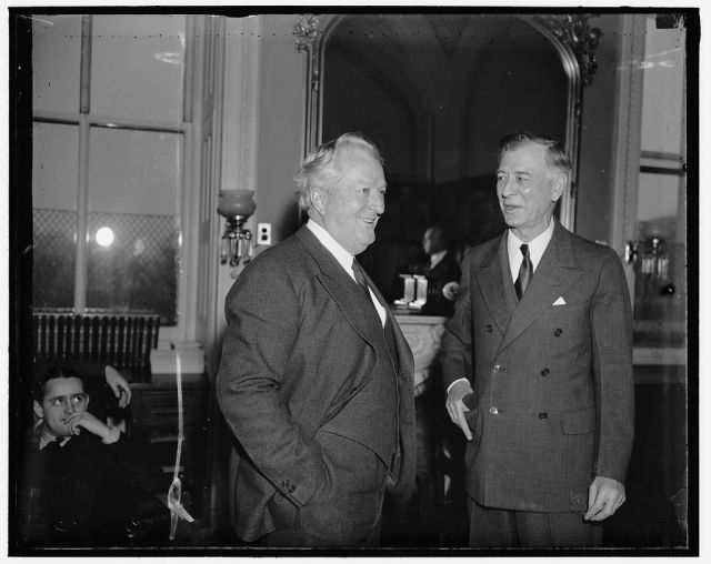 Senator Pat McCarran and Senator Key Pittman, (right) both Democrats from Nevada, exchanging opinions on President Roosevelt's proposal that the membership of the Supreme Court be increased to possibly 15 members. They are pictured as they attended a meeting of the Senate Judiciary Committee.