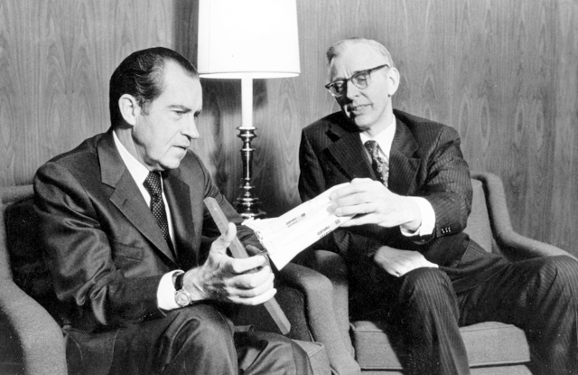 NASA Administrator James C. Fletcher meeting with President Richard Nixon on January 5, 1972, corning approval of the building of the Space Shuttle.