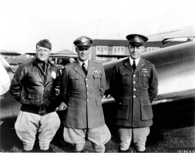 Black and white photo of three airmail of their plane