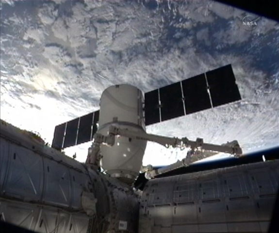 SpaceX Dragon capsule docked to the International Space Station in 2013.