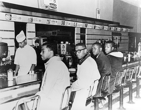 On the second day of the Greensboro sit-in, Joseph A. McNeil and Franklin E. McCain are joined by William Smith and Clarence Henderson at the Woolworth lunch counter in Greensboro, North Carolina.