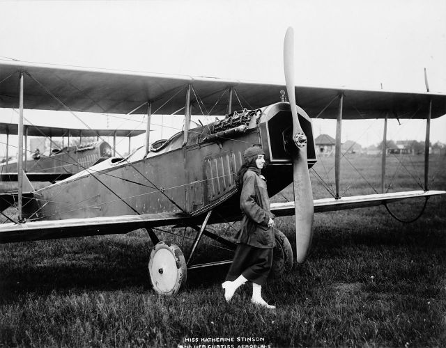 Katherine Stinson, as a nineteen year-old, preparing for a flight from Buffalo to Washington, D.C., in connection with the American Red Cross week.