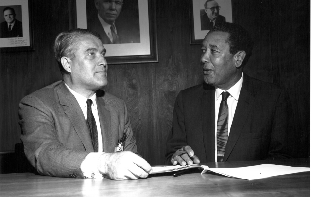 NASA Marshall center director, Dr. Wernher von Braun, and Alabama A&M University president, Dr. Richard D. Morrison, signing a cooperative agreement between the two institutions in November 1968.